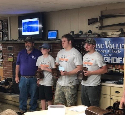 Harlan Campbell presented awards to the Mason Dixon team, which earned top honors at Pine Valley's youth shoot April 15. Team members included Rob Carpenter, Noah Temple and Erick Inch plus Chase Watkins and Travis Tyler (not pictured).