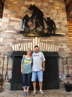 Alan and Laura McCord, owners of the Gateway GC, trapshooting at the Gateway Lodge, Land O'Lakes, WI. The three bears on the fireplace are the Gateway symbol.