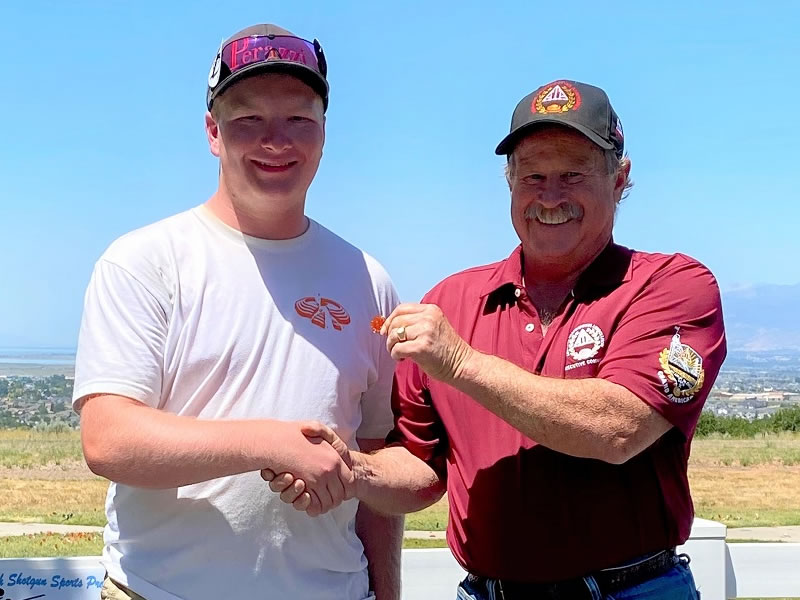 Zach Foster received his 27-yard pin from ATA Western Zone Vice President Ed Wehking. He earned his way to the back fence at the Western Zone Shoot