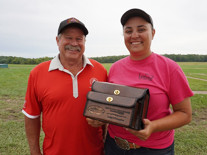 ATA Western Zone Vice President Ed Wehking congratulated Elizabeth Ternes on winning the Lady I Doubles title at the Grand
