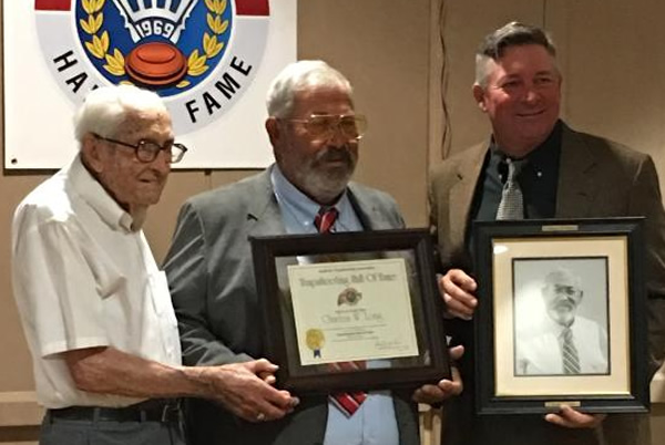 """Col. Thomas Long celebrated with his son at Charlie's Trapshooting Hall of Fame induction in 2019 along with Charlie's son """"L. C.,"""" who presented Charlie at the ceremony. Thomas passed away in February at the age of 107."""