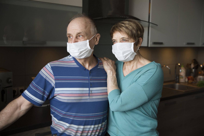 medicare changes during the coronavirus pandemic how covid-19 has impacted medicare senior couple wearing coronavirus masks