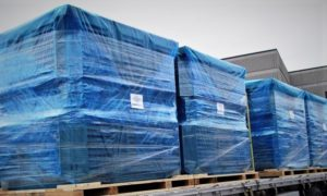 VCI Plastic Films Shrink Wrap film protecting skids of products on a flatbed truck