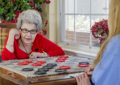 Playing checkers at the game table.
