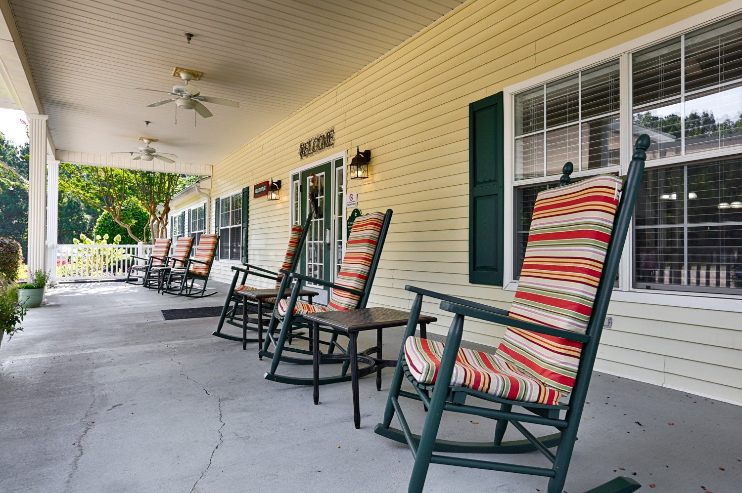 The Cottages Decatur, AL location outdoor space - front porch with rocking chairs