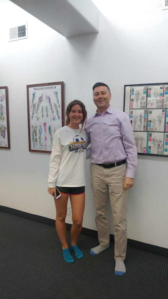 Young star athlete with Dr. Shouka at ChiroActiveTherapy in Tustin