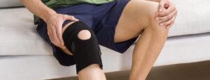 man with arthritis and knee brace