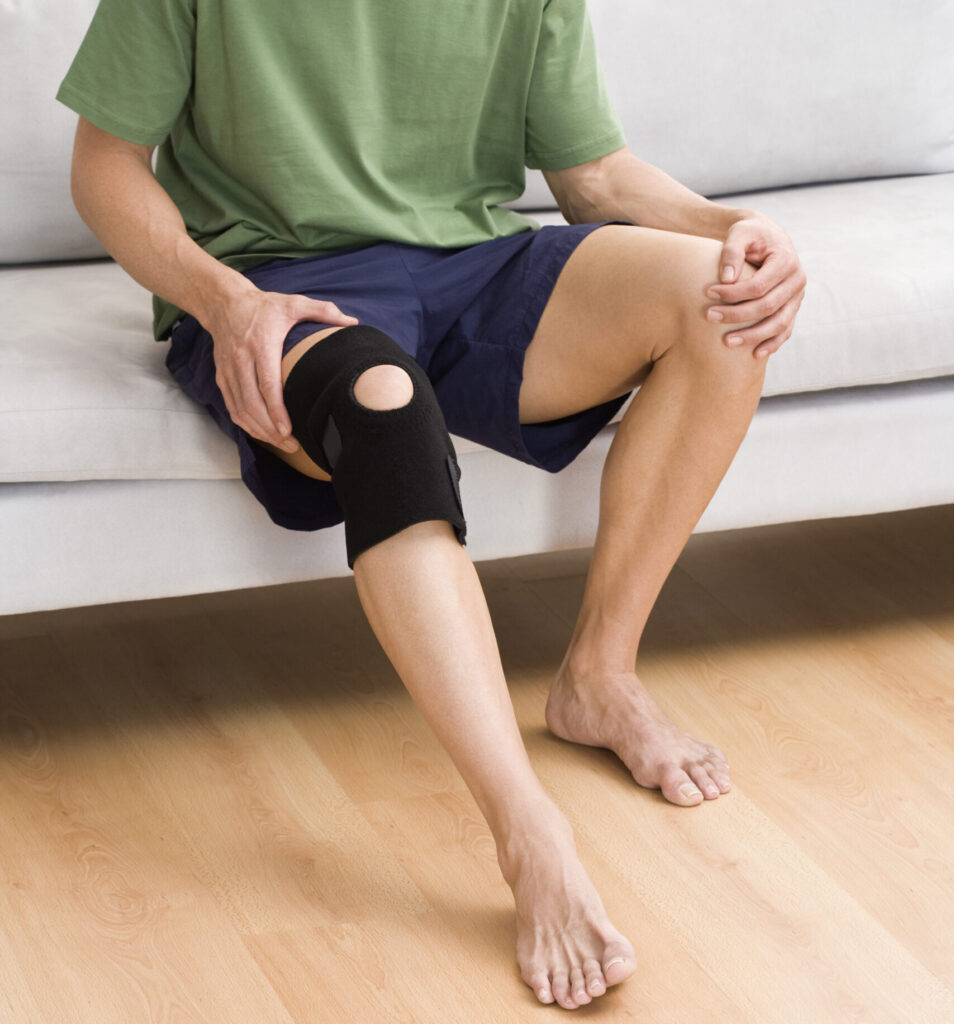man with arthritis and knee brace