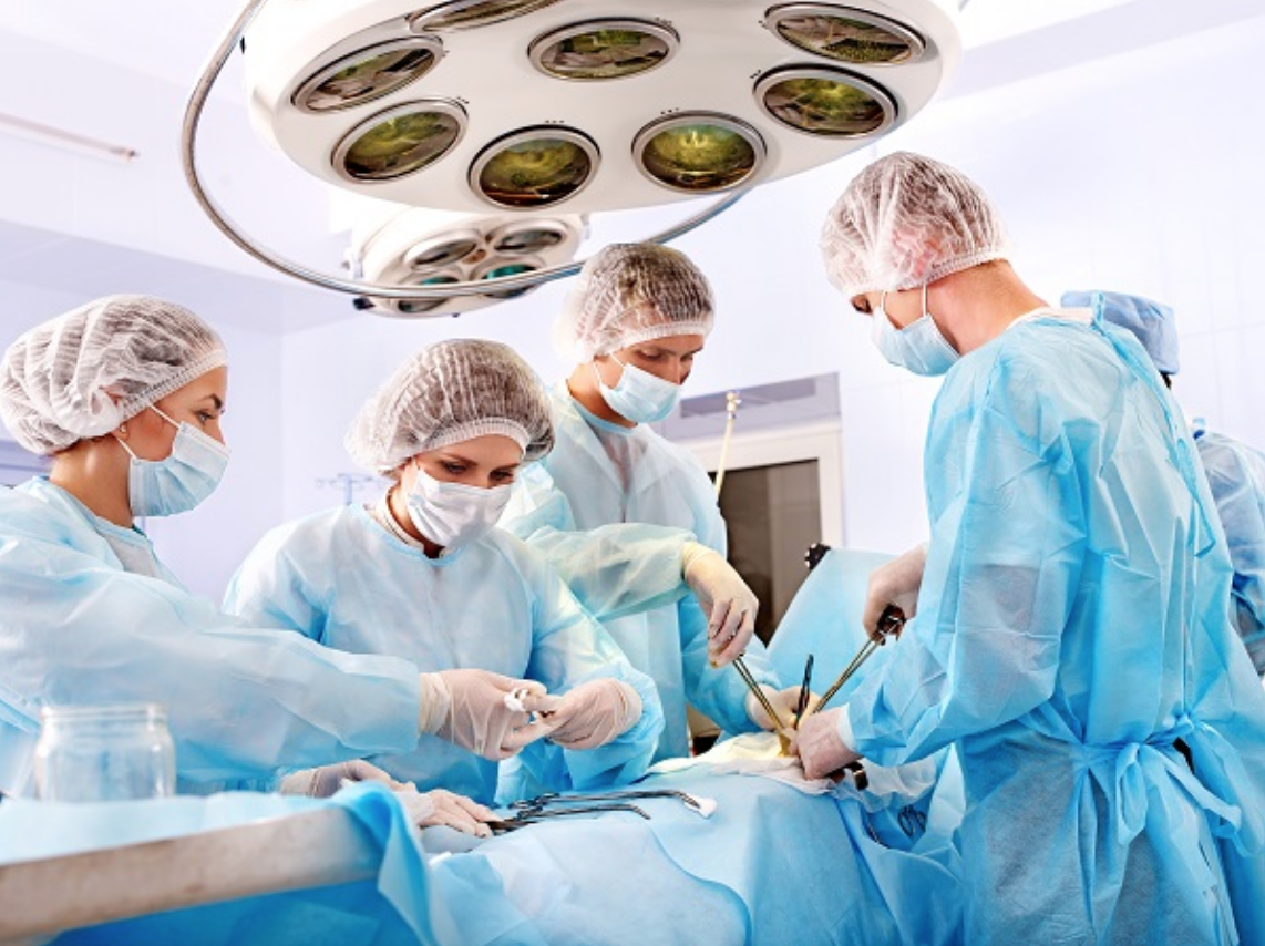 Surgeons performing heart surgery on a patient