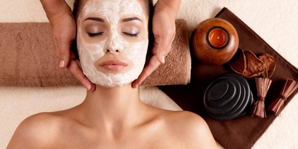 woman having facial skin care treatment