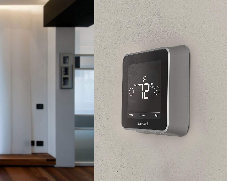 Honeywell Smart Thermostat on hallway wall.