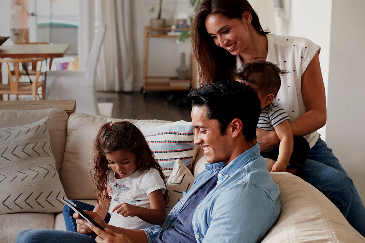 Family in living room enjoying new HVAC system.