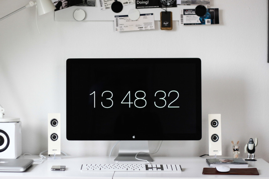 desktop computer workstation with digital clock display