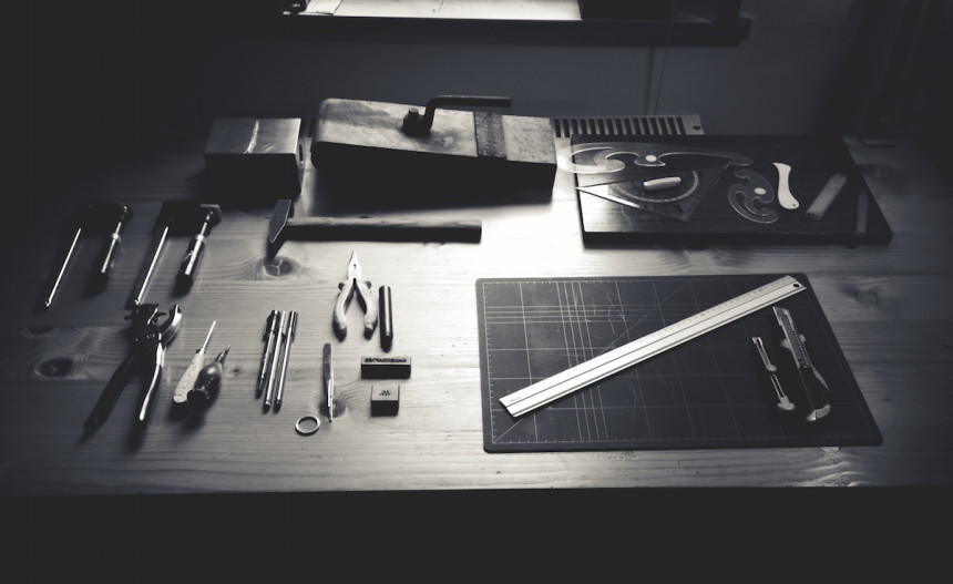 black and white drafting and tools desk