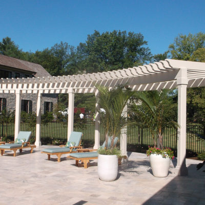 Backyard pergola with potted plants around a pool