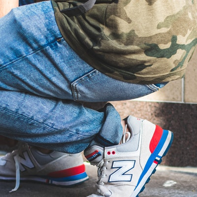 person-wearing-white-and-blue-new-balance-sneakers-2888667(1)