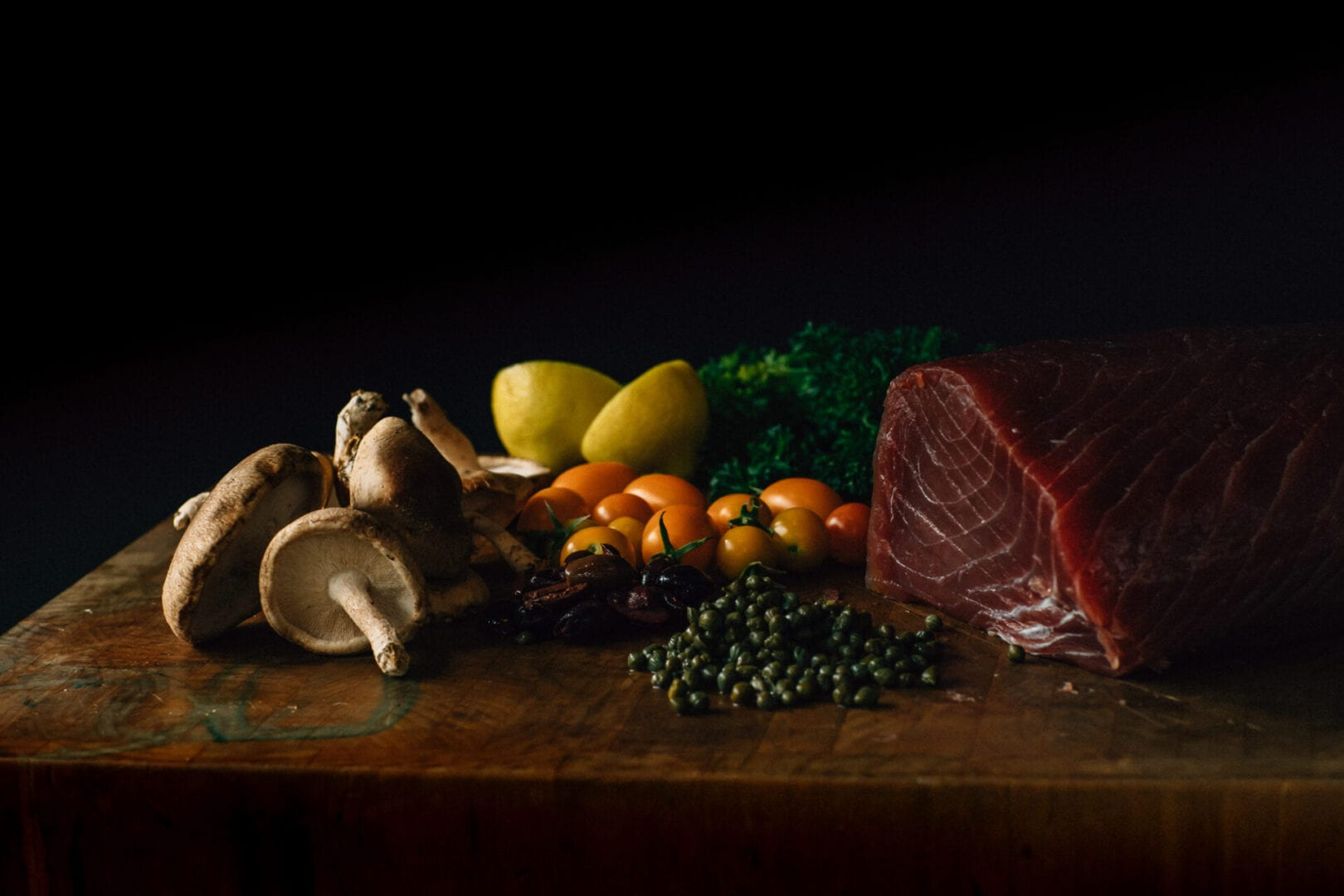 Delicious display of veggies and fresh tuna
