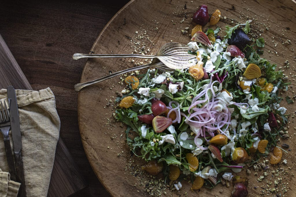 The Baby Beet Salad with pickled red onion, goat cheese, pistachios and avocado dressing