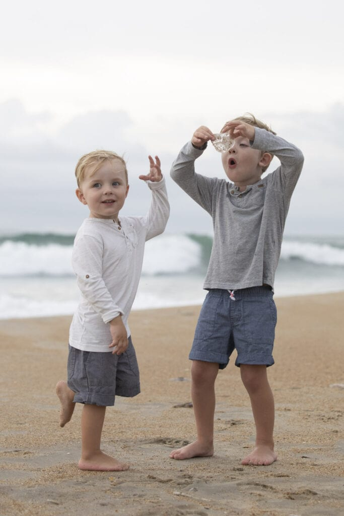 Boys playing with jelly fish on beach Duck NC