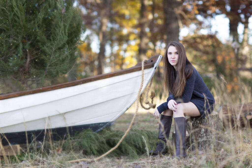 girl with old boat in field leesburg
