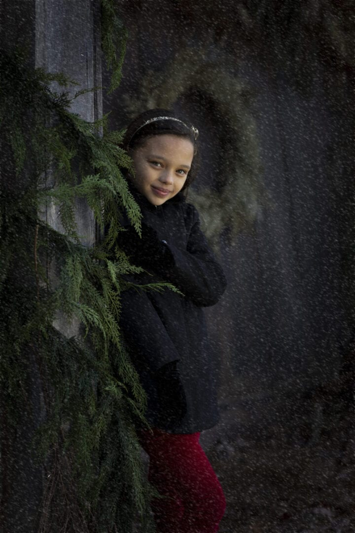 girl in light snow fall Loudoun County holiday mini session
