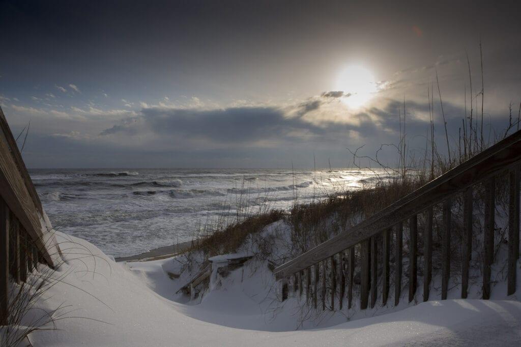 Snowy covered beach with sunrise Duck,NC