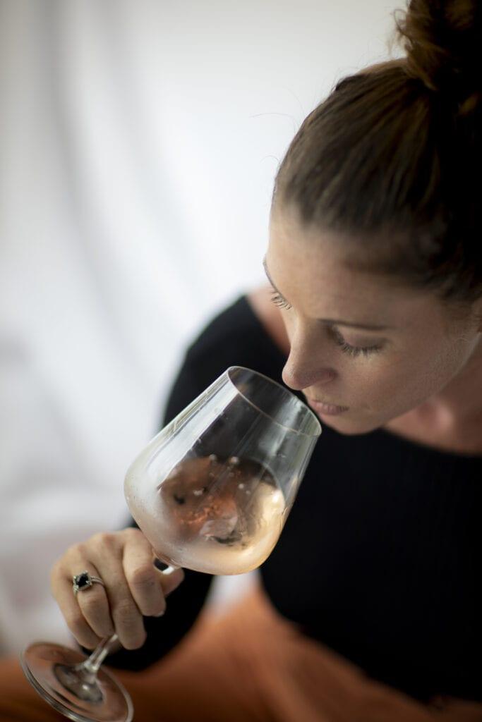 sommelier smelling rose wine