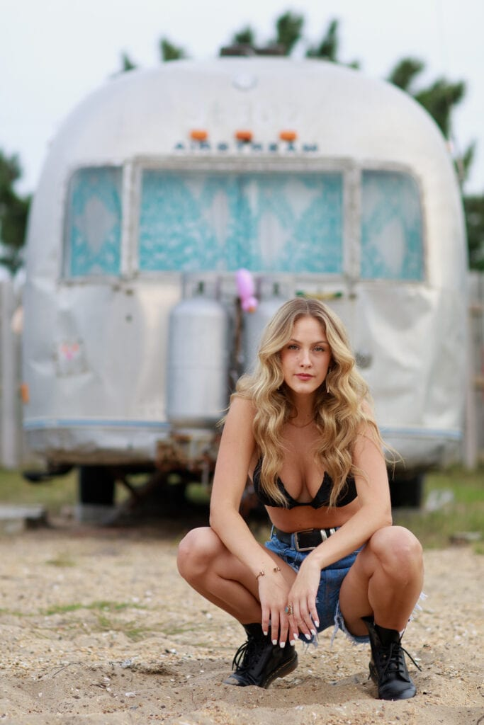 Sultry girl in front of Airstream, Outer Banks, NC