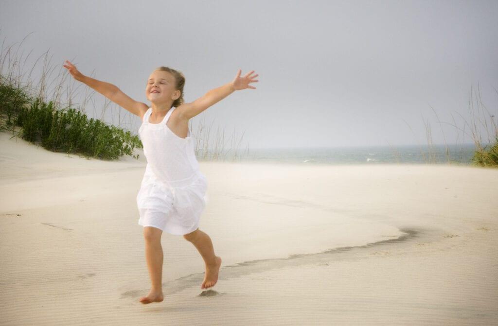 small girl loving the beach