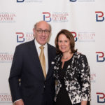 Honoree Ken Feinberg and Chair of the Board of Trustees Maria Rodriguez