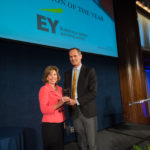 Patti Yoder accepting the Corporation of the Year award on behalf of EY