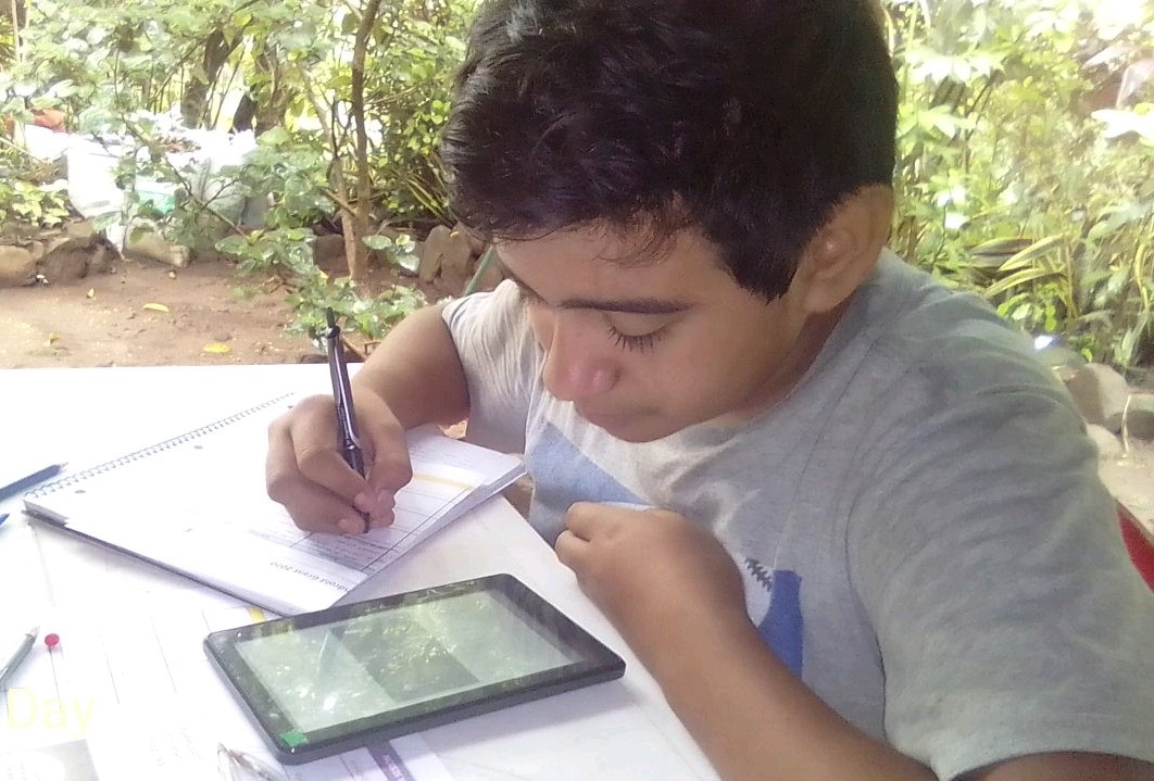 Joel is eager to continue his 8th grade curriculum offline, from home.