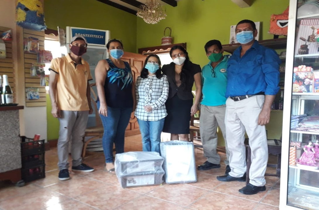 Coaches and the municipal director from Santa Lucía receiving their Lego kits.