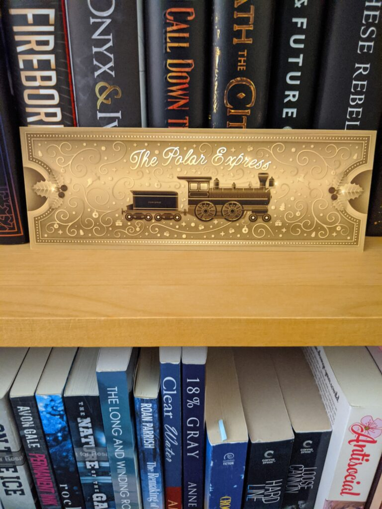 Day 16: a ticket to board the Polar Express. Probably the most useless item in the box so far.