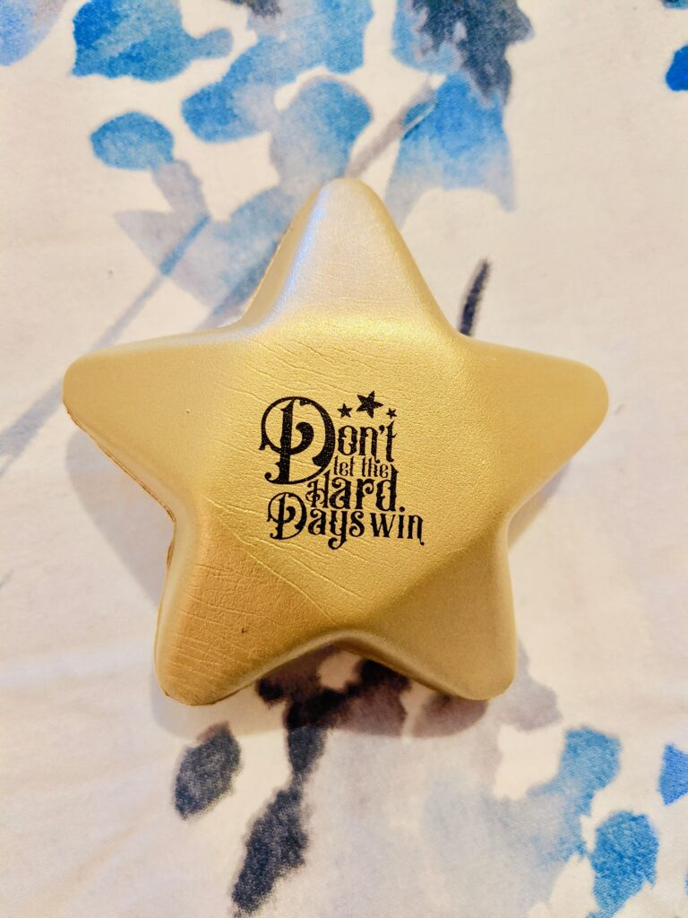 Day 18: a little, star-shaped stress ball. It's cute, but I won't get much use out of it.