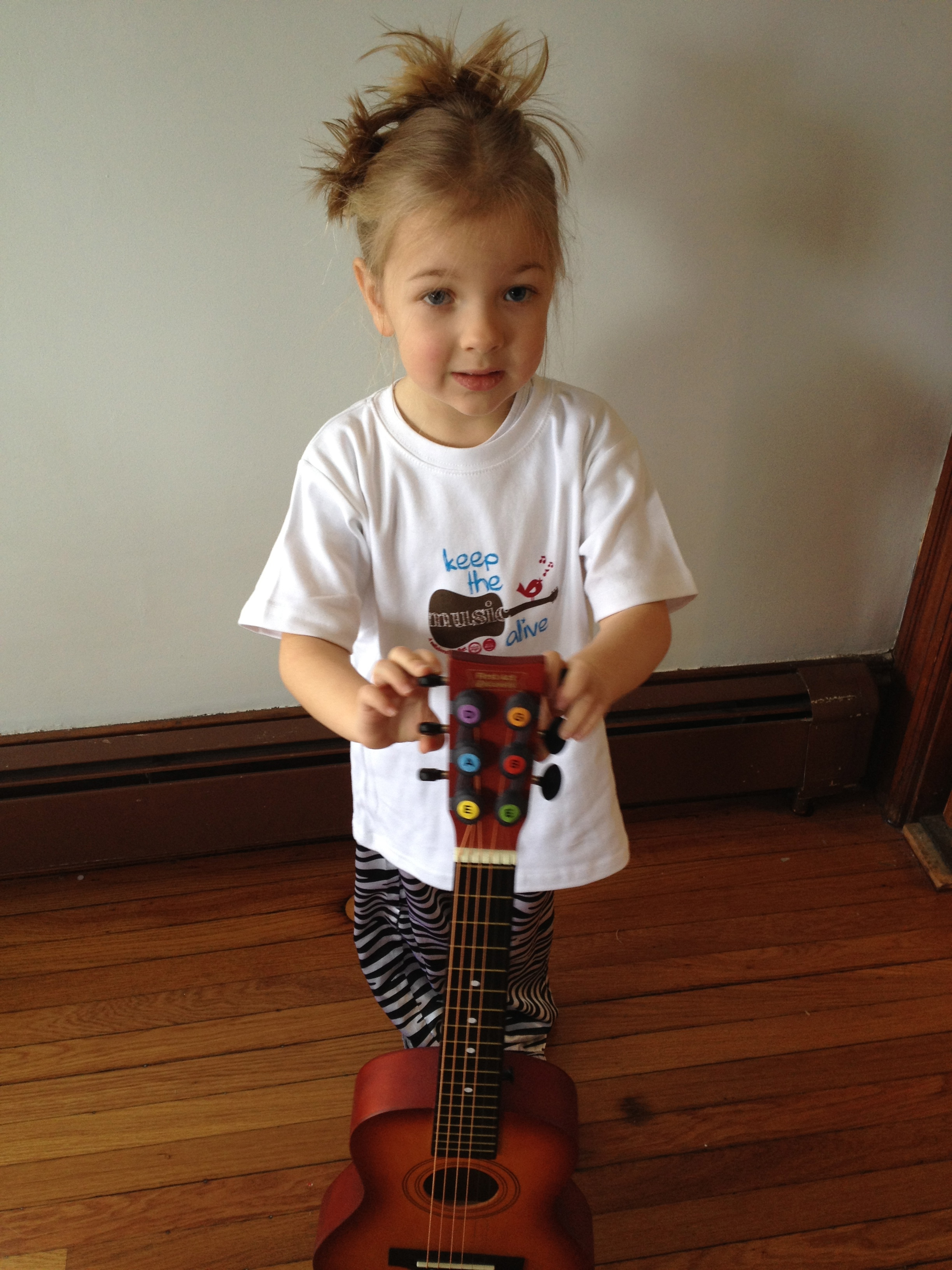 Eva in her Keep The Music Alive Tee