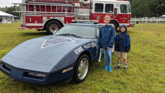 The kids check out the MSP Corvette