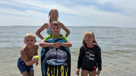 The Kids all Together on the Beach