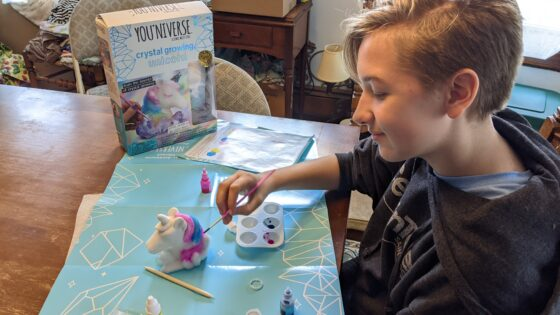 Eva painting her crystal unicorn