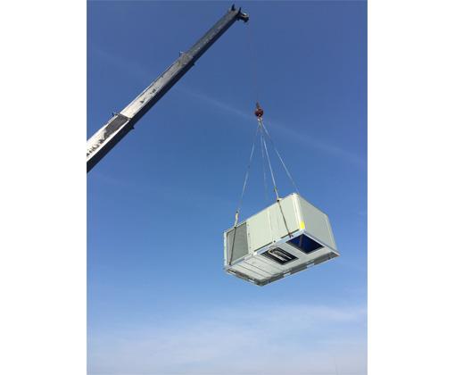 crane carrying an hvac