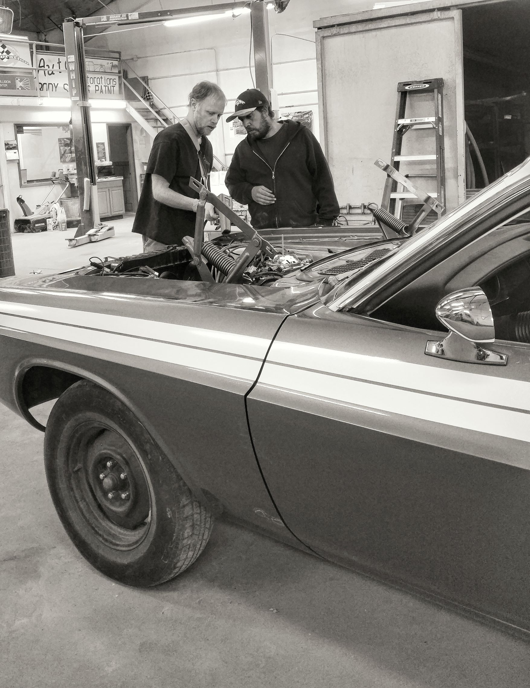 of our staff members working on a classic car restoration.