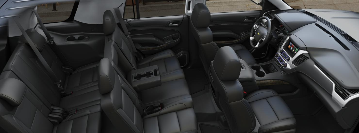 New Chevy Tahoe interior with leather interior, touch screen LCD display, multiple cup holders and third row seating.