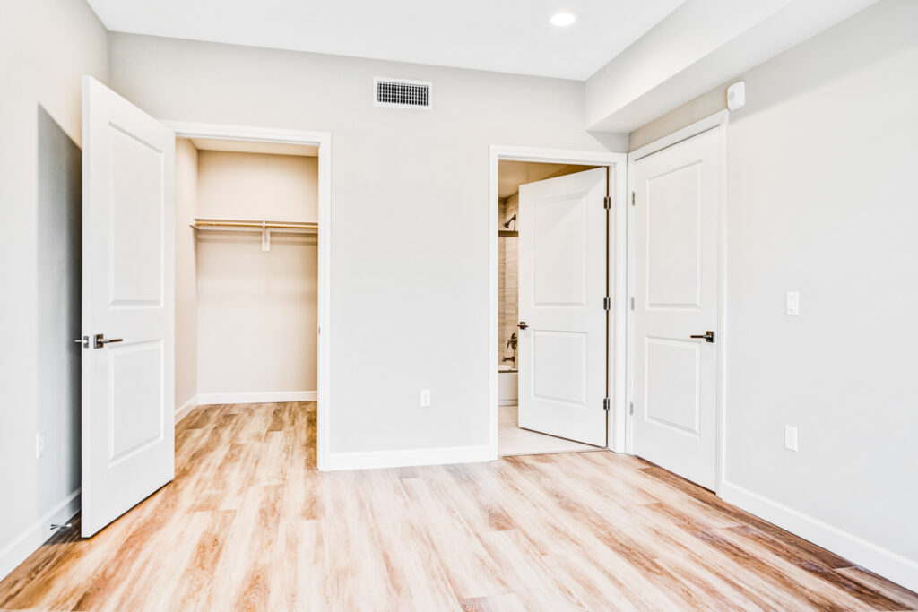 A look at storage and the private master bathroom from within the two-bedroom apartment unit.