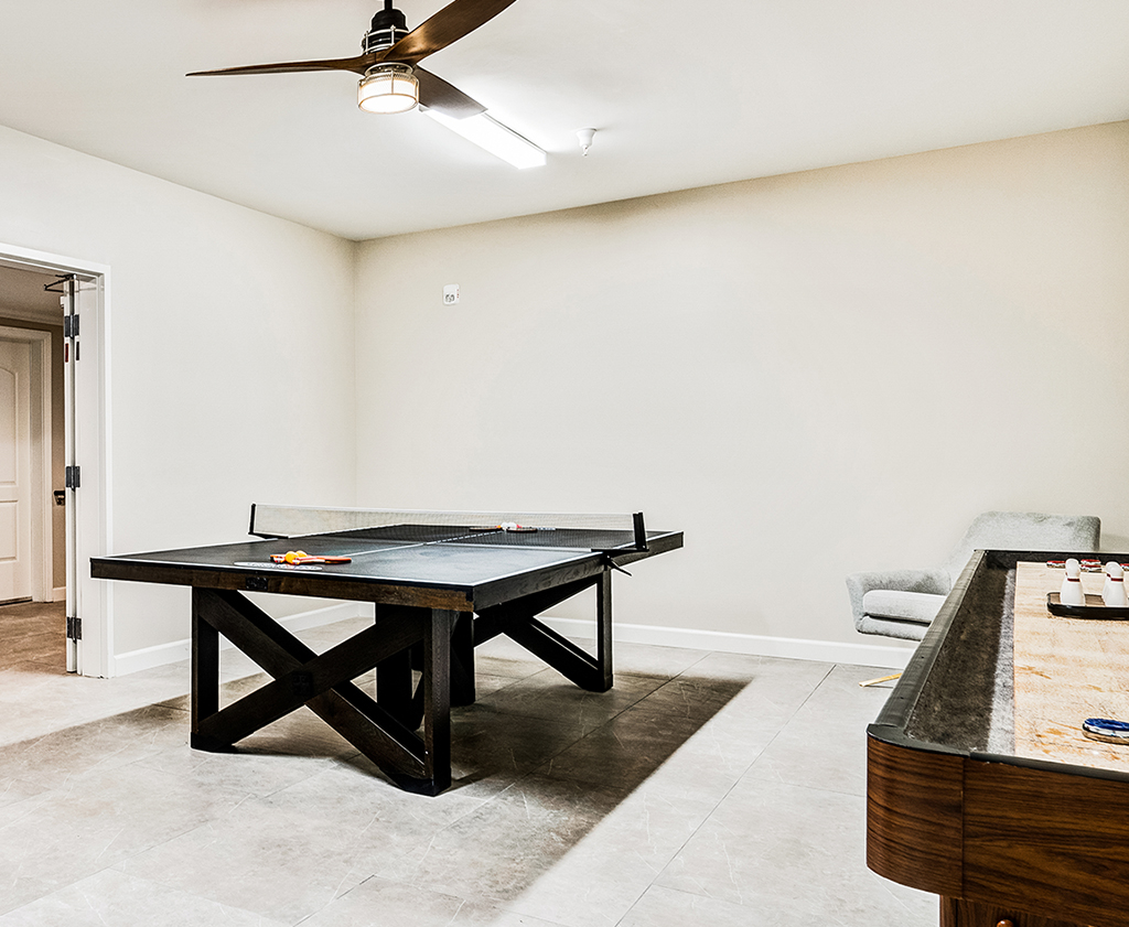A peek into the indoor gaming and sports room at Gladstone Senior Villas, featuring ping pong and more.