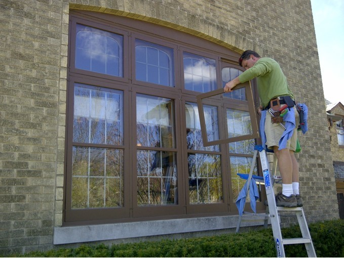 Man removing windows to clean