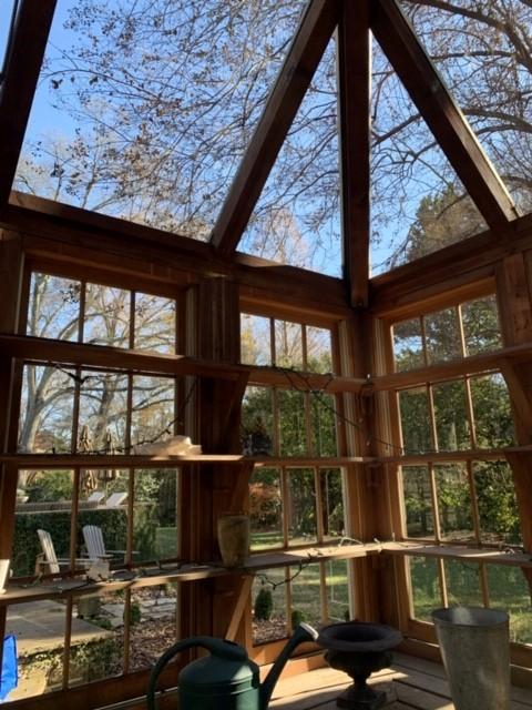 Sunroom with windows floor to ceiling