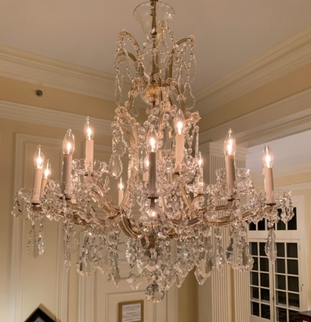 Cleaning chandeliers at the Duke Mansion