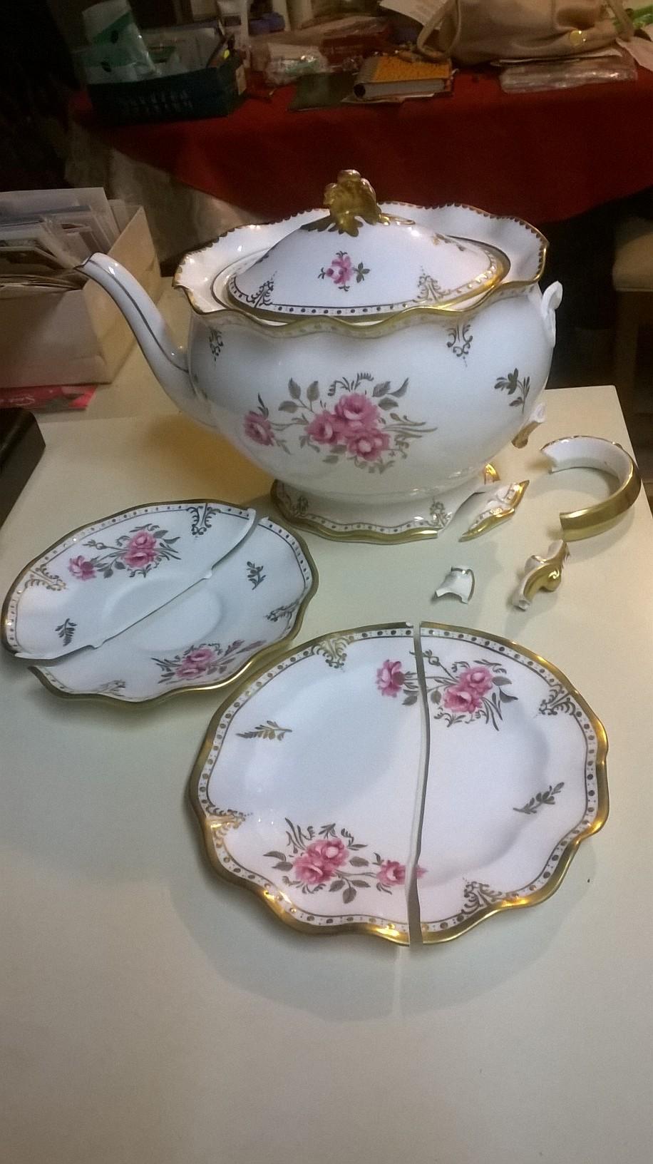 Broken teapot and saucers