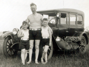 """Edwin Wilson and sons Lyman (left) and Charles camping with """"the Old Jalopy"""" (1927)"""