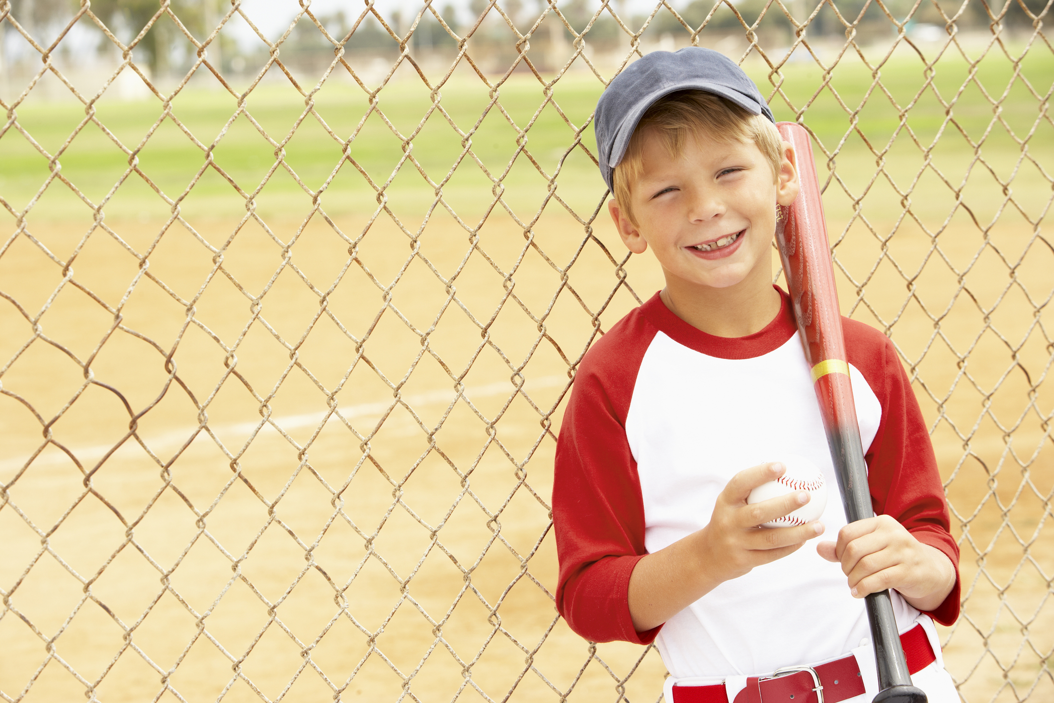 happy young boy with softball and bat
